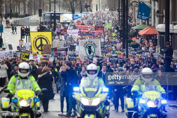 Thousands of protesters with banners and placards march through central London during a demonstration against US President Donald Trump on February 4...