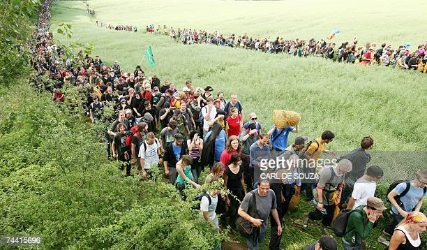 Thousands of protestors cross fields to blockade the roads and rail network near Reddelich northeastern Germany where antiG8 protesters have one of...