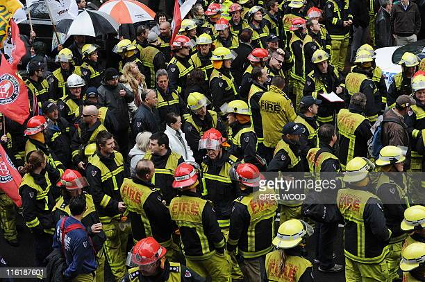 Thousands of public sector workers including firefighters hold a mass protest in Sydney's Macquarie Street outside the New South Wales state...