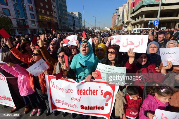 Thousands of public servants hold banners and shout slogans as they gather in front of Provincial Directorate of Education building during a...