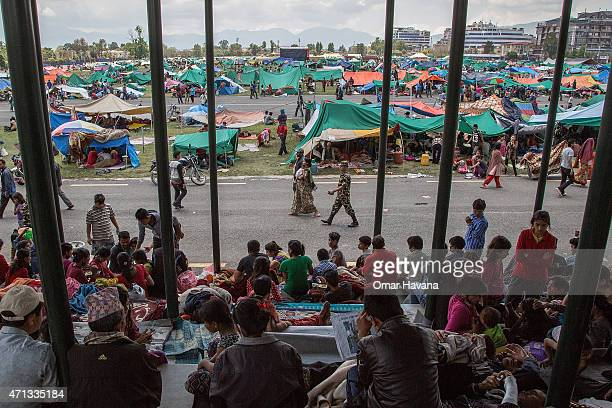 Thousands of residents take shelter in an evacuation area set up by the authorities in Tundhikel park on April 27, 2015 in Kathmandu, Nepal. A major...