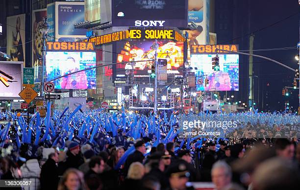 Thousands of revelers gather in New York's Times Square to celebrate the ball drop at the annual New Years Eve celebration on December 31 2011 in New...