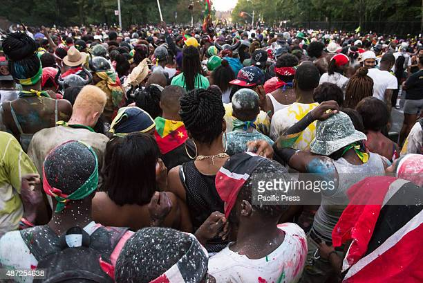 """Thousands of revelers took to the streets of Crown Heights beginning around 3:00 A.M. For a colorful and raucous pre-dawn """"J'ouvert"""" street..."""
