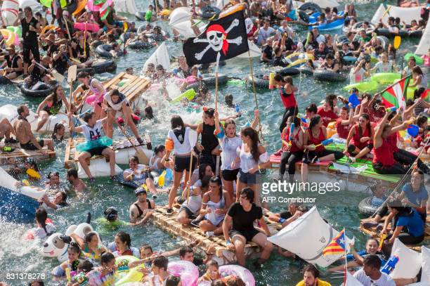Thousands of revellers try to navigate their handmade rafts in the port of the northen Spanish Basque city of San Sebastian during the 'Abordaje'...