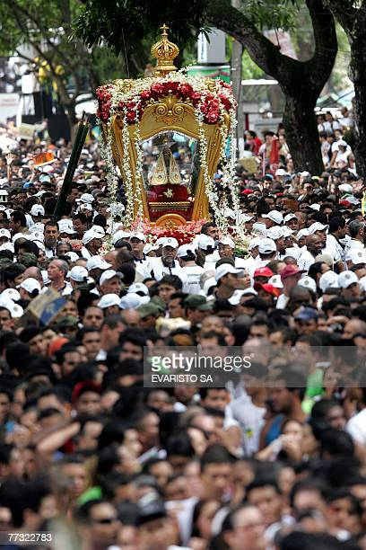 Thousands of Roman Catholic pilgrims attend the procession of the Our Lady of Nazareth's image in Belem do Para north of Brazil as part of the 'Cirio...
