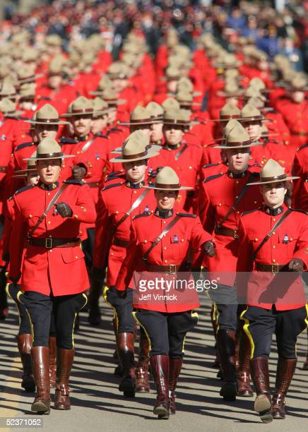 Thousands of Royal Canadian Mounted Police officers march on route to a memorial service to honor the officers who were murdered last week March 10...