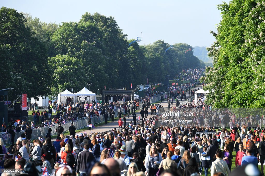Thousands of Royal fans cram onto the Long Walk before the wedding of Prince Harry to Ms. Meghan Markle St George's Chapel, Windsor Castle on May 19, 2018 in Windsor, England. Prince Henry Charles Albert David of Wales marries Ms. Meghan Markle in a service at St George's Chapel inside the grounds of Windsor Castle. Among the guests were 2200 members of the public, the royal family and Ms. Markle's Mother Doria Ragland.