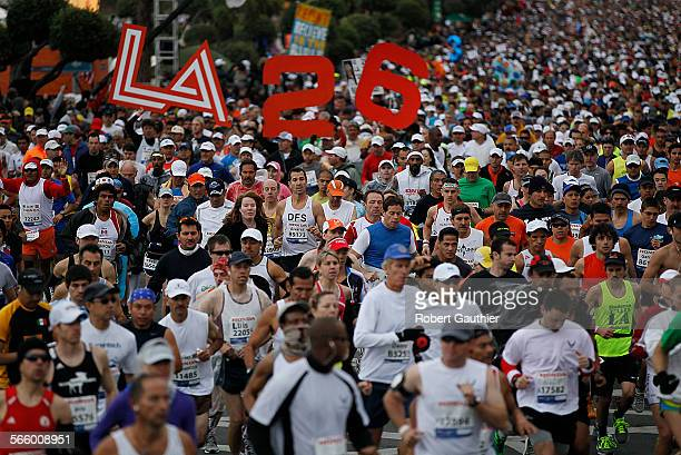 Thousands of runners begin a 26 mile journey at the start of the LA Marathon at Dodger Stadium