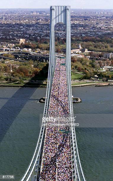 Thousands of runners cross the VerrazanoNarrows bridge at the start of the New York City Marathon November 7 1999 Over 30000 men and women run in the...