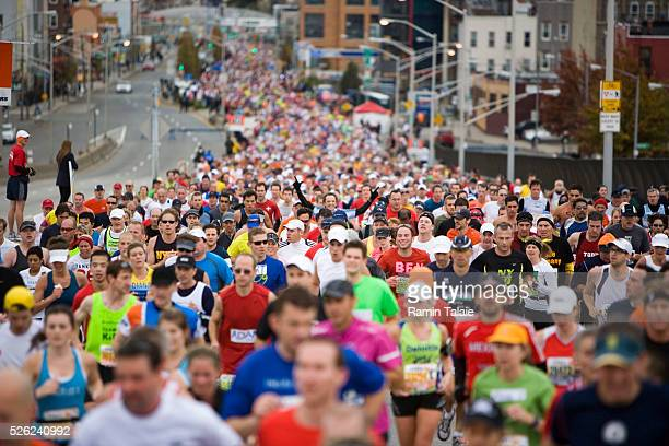 Thousands of runners pack a road as they pass through the borough of Brooklyn during the 40th ING New York City Marathon on November 1 2009 Ramin...