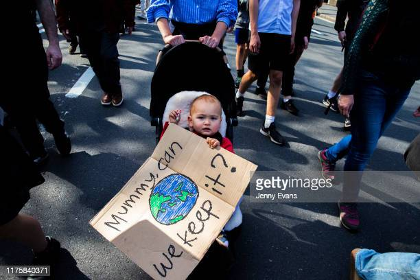 Thousands of school students and protesters march along College Street during a climate strike rally on September 20, 2019 in Sydney, Australia....