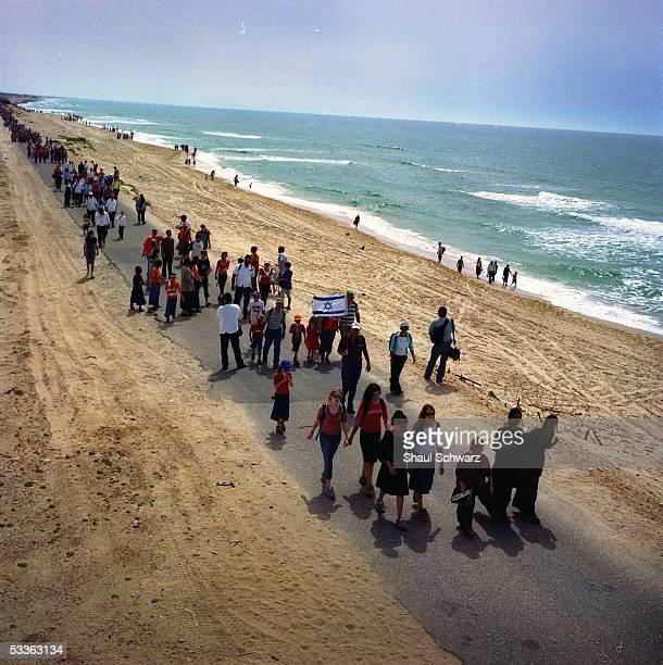 Thousands of settlers and rightwing supporters march near the beach in the Gush Katif bloc of settlements April 27 2005 in the heart of the Gaza...