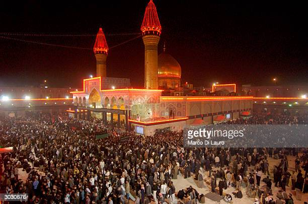Thousands of Shiah Muslims push to enter Ali Hussein Mosque to express grief at Ali's death during Muharram celebrations March 1 2004 in Karbala Iraq...