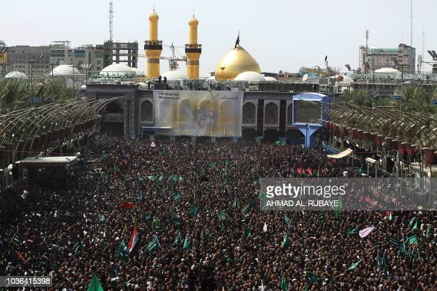 Thousands of Shiite Muslims take part in Ashura mourning at Imam Hussein's shrine in the Iraqi holy city of Karbala on September 20 2018 Ashura marks...