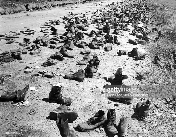 Thousands of shoes discarded by communist prisonersofwar on the road near Panmunjom on the border between North and South Korea 4th September 1953...