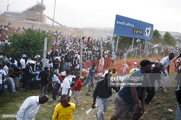 Thousands of soccer fans leave FNB stadium after a derby between local teams Kaizer Chiefs and Orlando Pirates on December 9, 2006 in Johannesburg,...