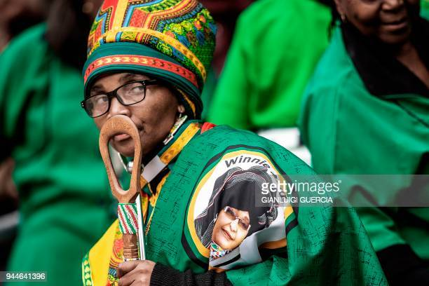 TOPSHOT Thousands of South African ruling Party African National Congress supporters and mourners sing and dance during a memorial service for late...