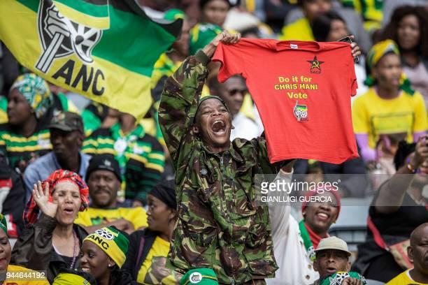 Thousands of South African ruling Party African National Congress supporters and mourners sing and dance during a memorial service for the late...