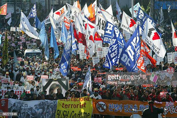Thousands of South Korean protesters take to the streets during an anti APEC rally on November 18 2005 in Pusan South Korea AntiAmerican protesters...
