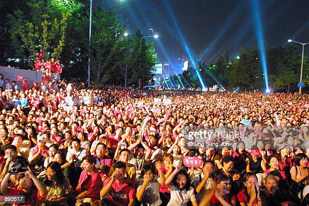 Thousands of South Korean soccer fans cheer during a festival to celebrate the success of the South Korean team taking fourth place in the 2002 World...