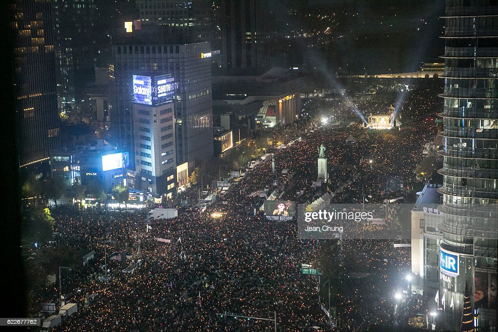 Thousands of South Koreans take to the streets in the city centre to participate in a candlelight rally to demand President Park Geun-Hye to step down on November 12, 2016 in Seoul, South Korea. Approximately tens of thousands of people joined the anti-government protest amid rising public frustration for President Park Geun-hye after a corruption scandal.