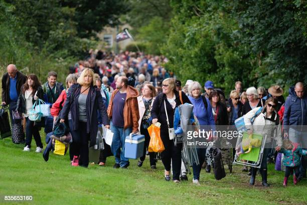 Thousands of spectators arrive as they attend the annual Castle Howard Proms Spectacular concert held on the grounds of the Castle Howard estate on...