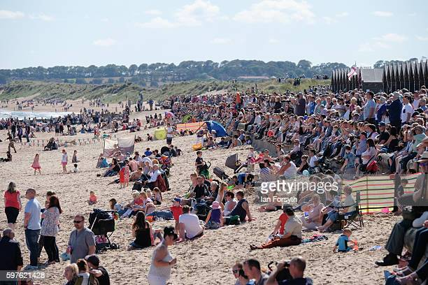 Thousands of spectators line the seafront and beach to watch the North Sea Tall Ships Parade of Sail on August 29 2016 in Blyth England The bustling...