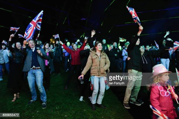 Thousands of spectators react to the music as they attend the annual Castle Howard Proms Spectacular concert held on the grounds of the Castle Howard...