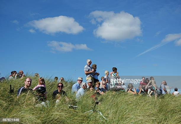 Thousands of spectators stand in the dunes and watch the North Sea Tall Ships Parade of Sail on August 29 2016 in Blyth England The bustling port...