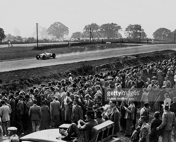 Thousands of spectators watch as Bernd Rosemeyer drives the Auto Union Type C during the Donington Grand Prix on 2 October 1937 at Donington Park...