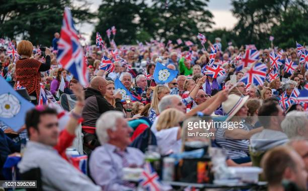 Thousands of spectators wave Union Flags as they enjoy the music during Yorkshire's biggest openair proms of the summer at Castle Howard on August 18...