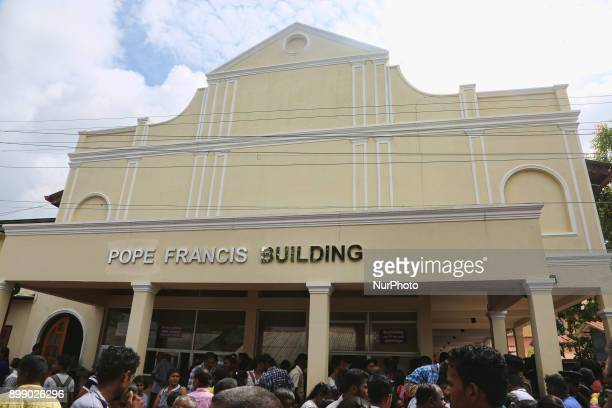 Thousands of Sri Lankan Catholics pilgrims pass by the Pope Francis Building as they walk to the Shrine of Our Lady of Madhu during the Feast of Our...