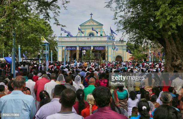 Thousands of Sri Lankan Catholics pray during the Feast of Our Lady of Madhu in Mannar Sri Lanka With a history of over 400 years this shrine acts as...