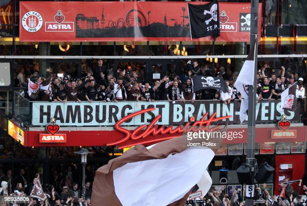 "Thousands of St. Pauli fans celebrate together with the team of St. Pauli on the ""Spielbudenplatz"" after the Second Bundesliga match between FC St...."