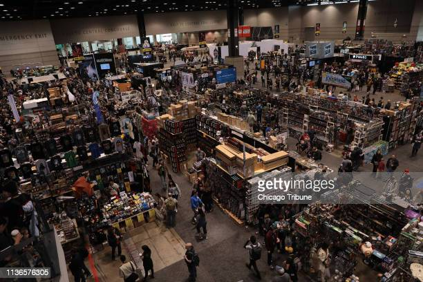 Thousands of Star Wars fans look up at the screens to view actors, actresses and others during the Star Wars Celebration, at McCormick Place in...