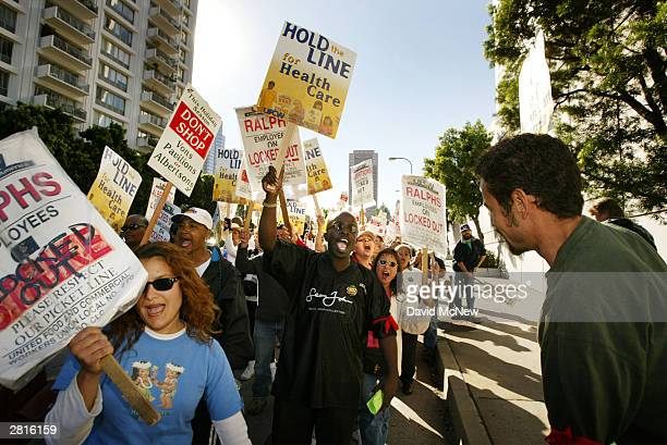 Thousands of strikers and supporters march to a rally at a Pavilions supermarket December 16, 2003 in Beverly Hills, California. Locked-out and...