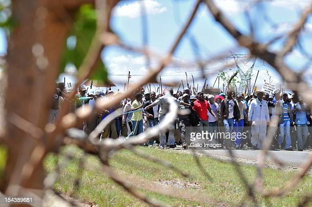 Thousands of striking Gold Fields miners gather near the Anglo Gold Ashanti mine for a mass meeting on October 18 2012 in Fochville South Africa The...