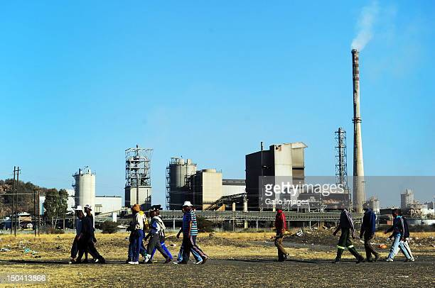 Thousands of striking mine workers demonstrate near Lonmin's Karee Platinum Mine demanding a wage increase on August 16 2012 in Rustenburg South...