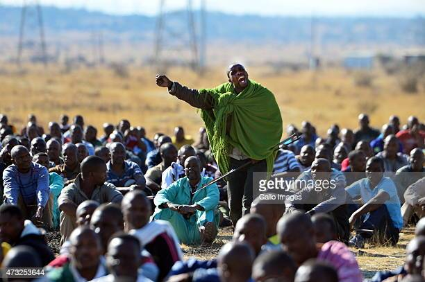 Thousands of striking mine workers demonstrate on a hill near Lonmins Karee Platinum Mine demanding a wage increase on August 16 2012 in Rustenburg...