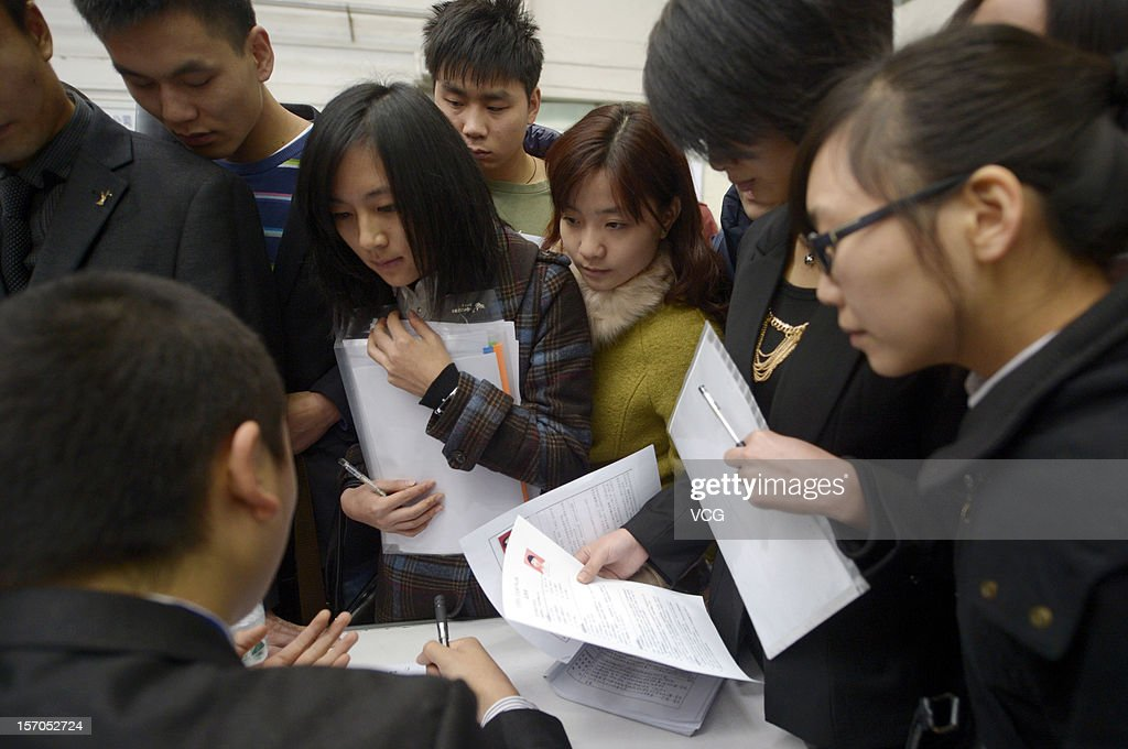 Thousands of students apply for jobs during a job fair for graduates at Chongqing Exhibition Center on November 27, 2012 in Chongqing, China. More than 10,000 job positions are provided by nearly 1,000 firms in the three-day fair, which will attract more than 60,000 graduates in Chongqing.