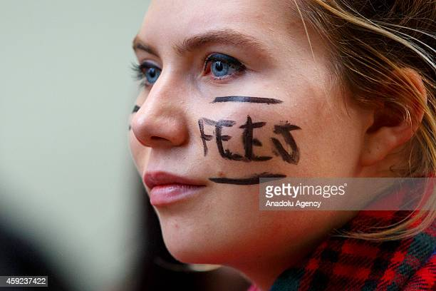 Thousands of students attend a march against tuition fees and spending cuts in London England on November 19 2014