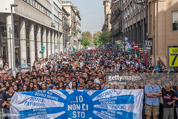 Thousands of students march holding banners across the streets of Italy to protest against the government's labor and education reforms