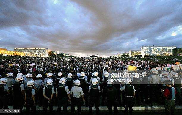 Thousands of students stand in the gardens of the National Congress during a protest, on June 17, 2013 in Brasilia. Tens of thousands of people took...