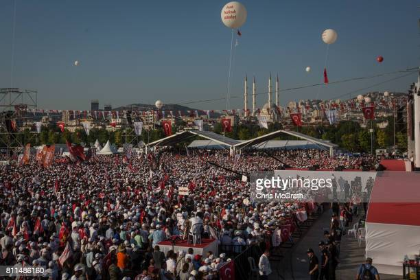 Thousands of supporters cheer and wave flags while listening to Turkey's main opposition Republican People's Party leader Kemal Kilicdaroglu speak on...