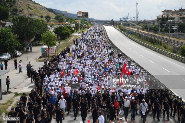 Thousands of supporters of Republican People's Party deputy Veli Agbaba take part in Izmit on July 5 2017 in the 21st day of a threeweek march for...