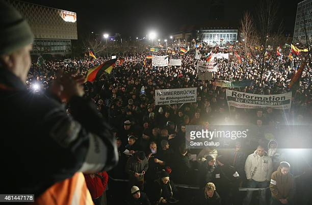 Thousands of supporters of the Pegida movement gather during their weekly protest on January 12 2015 in Dresden Germany Pegida is an acronym for...