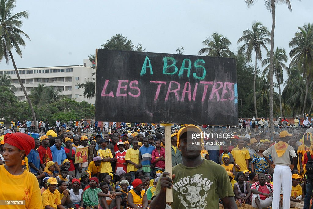 Thousands of supporters of Togo's main opposition party demonstrate on May 29, 2010 in Lome against its leader's agreement to join the government, which has split the Union of Forces for Change (UFC). Thousands of President Faure Gnassingbe supporters also demonstrated in a separate part of Lome on Saturday to back the president's 'policy of reconciliation, social peacemaking and openness', in the words of RPT secretary general Silitoko Esso. (Placard reads: Down with traitors). AFP PHOTO / Emile Kouton