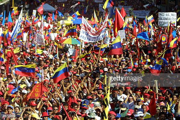 Thousands of supporters of Venezuela's President Hugo Chavez gather December 7 2002 in front of the Miraflores presidential palace in Caracas...