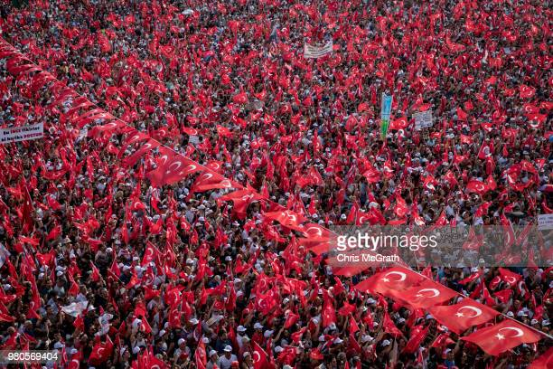 Thousands of supporters wave flags and chant slogans while waiting for the arrival of CHP Party presidential candidate Muharrem Ince during a...