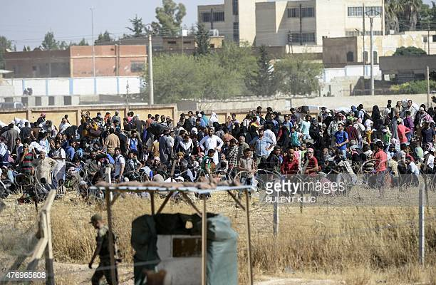 Thousands of Syrians run away from center Tal Abyad after they heard Kurdish fighters are coming at the Turkish Akcakale crossing gate in Sanliurfa...